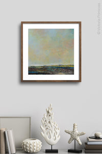 "Serene abstract beach painting ""Twilight Blush,"" canvas art print by Victoria Primicias, decorates the dining room."