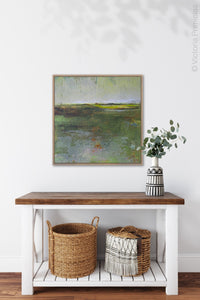 "Green abstract landscape painting ""Verdant Excuse,"" digital print by Victoria Primicias, decorates the hallway."