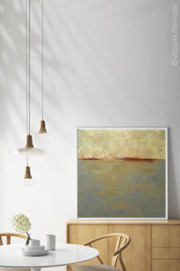 "Minimalist abstract ocean art ""Whispering Waters,"" fine art print by Victoria Primicias, decorates the dining room."
