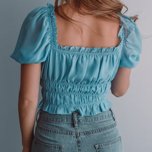 Blue puff short sleeve crop top with a drawstring centre and shirred waist