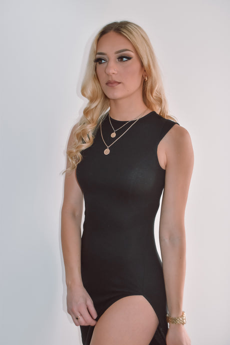 Casual black ribbed slit dress with a high neckline.