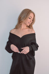 Black heavy knit long cardigan. Can be worn as a dress or over your clothes. Centre front button fasternings and a knited black belt.
