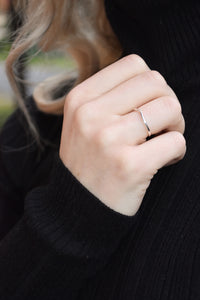 Sterling silver thin subtle wave ring.