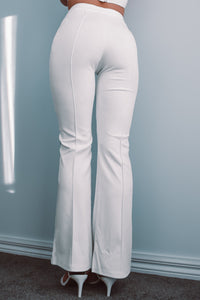 White panel trouser pants. Tight at the top with a slight boot leg.
