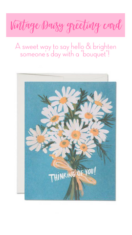 blue card with white and yellow daisies illustrated greeting card