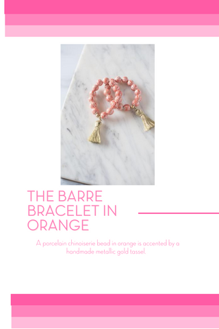 orange and white chinoiserie beaded bracelet with gold tassel