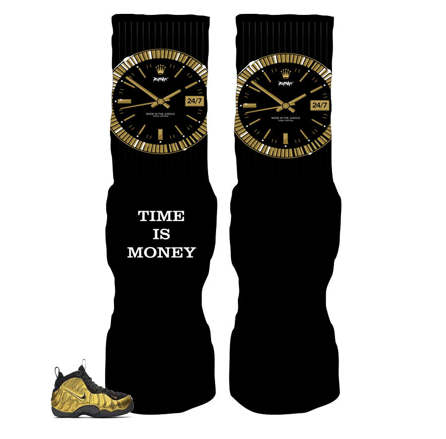 Elite socks match foamposite metallic gold shoes.