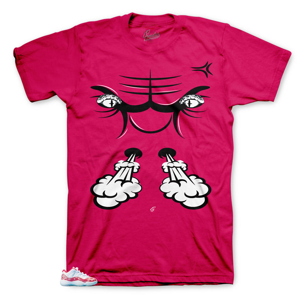 Jordan 11 pink snake skin low top kicks has matching jordan 11  shirts designed to match the pink snakeskin