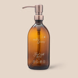 British-made amber glass bottle with bronzed pump