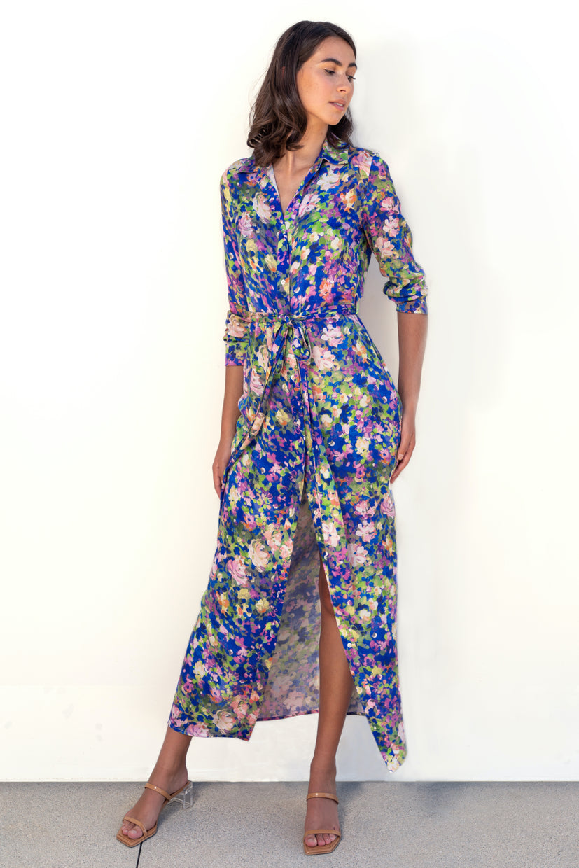 Finchley Camino's maxi length button-down long-sleeve collared dress with a waist tie belt in an original blue floral print.