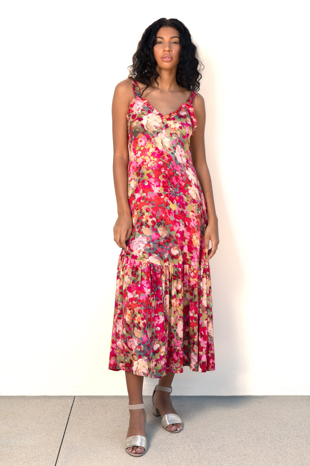 Model wears Finchley Camino's red floral printed maxi length dress with large ruffle hem and sweetheart neckline with ruffle trim