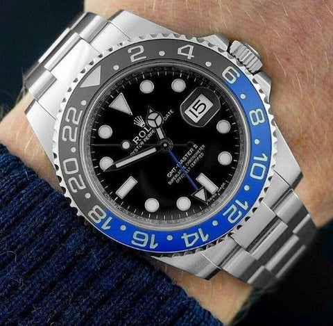 Image of a rolex batman on a wrist