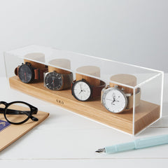 4 watch watch box made of wood and has a glass enclosure