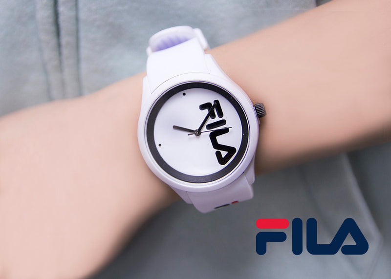 Close up of model wearing Picture of FILA | 38-129-210 | Men and Women's White Analog Watch | Water Resistant with a grey zip up hoodie