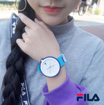 Picture with the key features of FILA | 38-315-007DBWH | Men's and Women's Red and Blue Analog Watch | Water Resistant | Interchangeable Case being worn by a model with a grey sweater