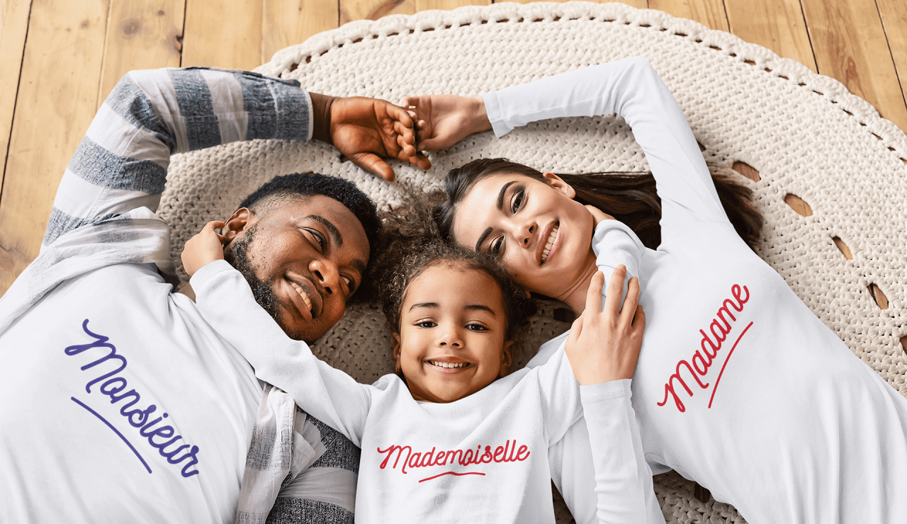 t-shirt mockup of a family of three lying together