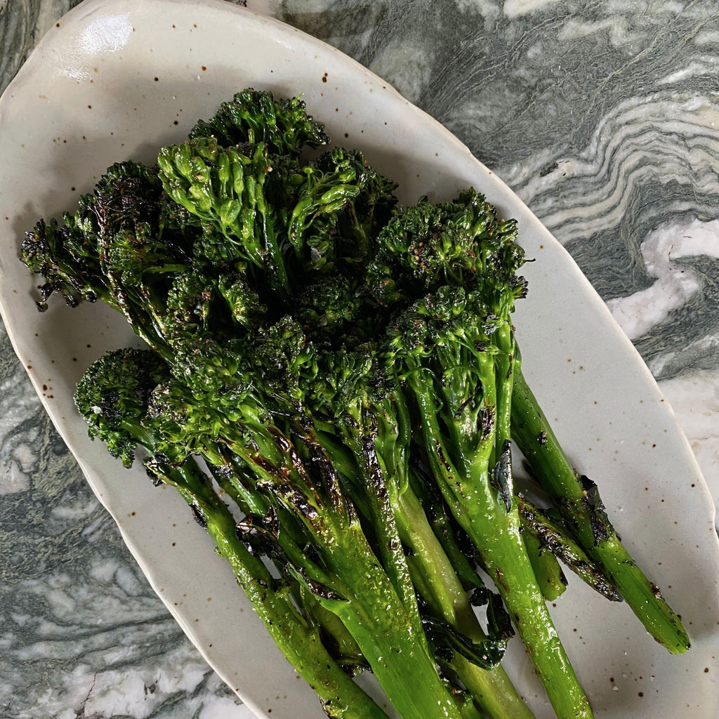 Roasted broccolini on a serving plate