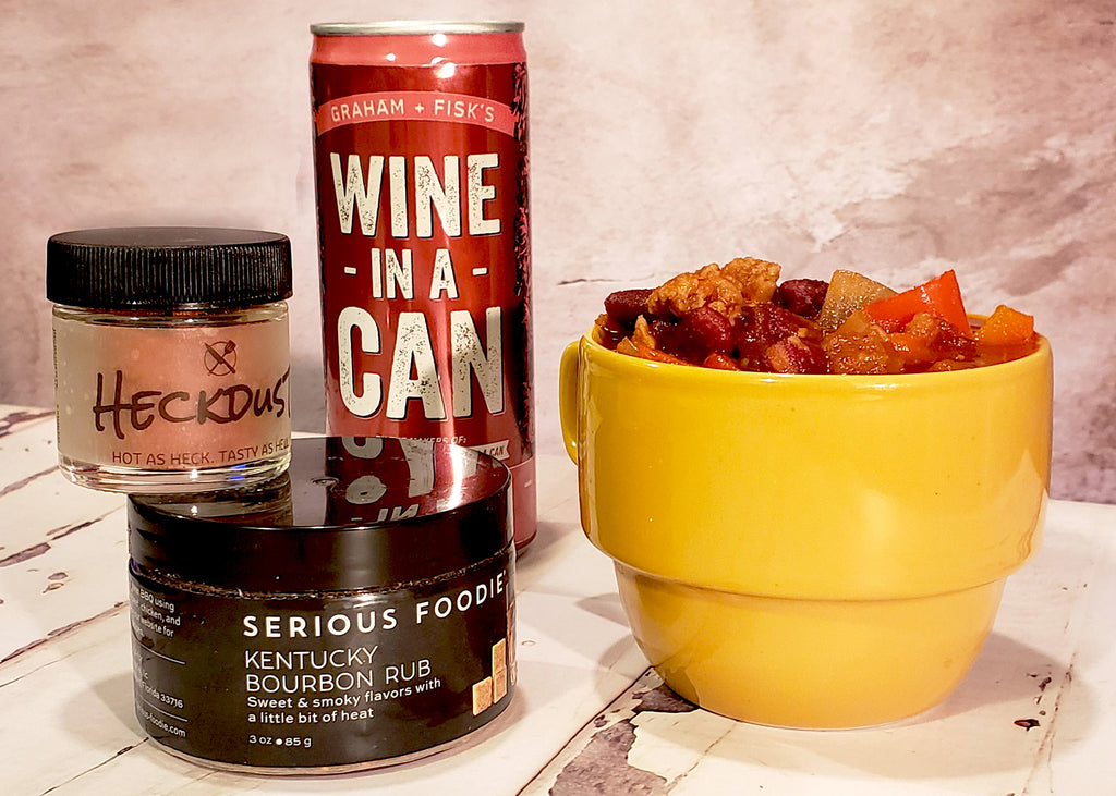 Culinarie Kit's Heckdust, Serious Foodie's Kentucky Bourbon Spice Rub, Graham and Fisks's Wine in a Can Red with a bowl of chili