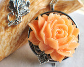 Music box locket, round locket with music box inside, in silver with peach rose and silver filigree accent, permanently sealed