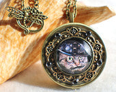 Music box locket,  round locket with music box inside, in bronze with Steampunk Cat cabochon on front cover.