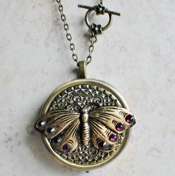 Music box locket,  round locket with music box inside, in bronze with filigree and butterfly adorning front cover. - Char's Favorite Things - 4