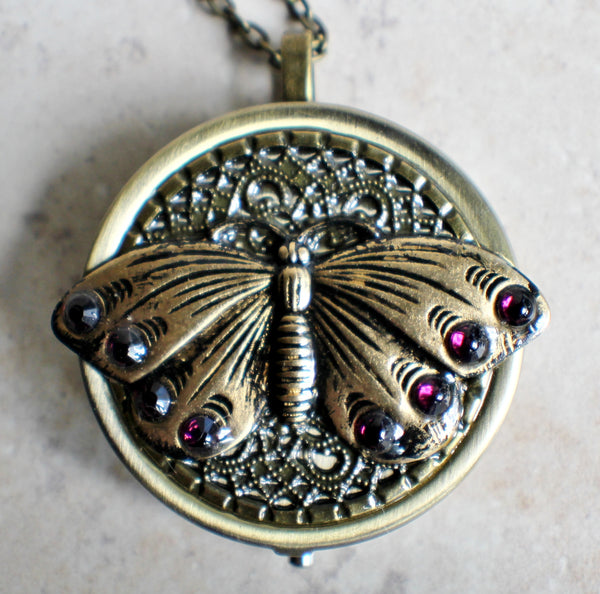 Music box locket,  round locket with music box inside, in bronze with filigree and butterfly adorning front cover. - Char's Favorite Things - 3