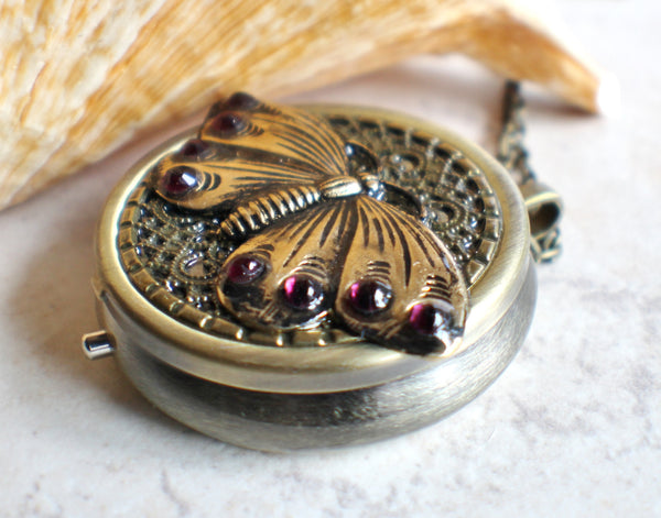 Music box locket,  round locket with music box inside, in bronze with filigree and butterfly adorning front cover. - Char's Favorite Things - 2