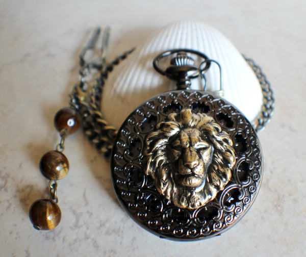 Bronze lion pocket watch, mechanical pocket watch in black.