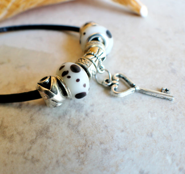 Key charm bracelet on black leather band