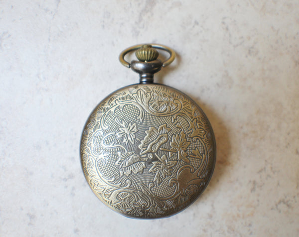 Horse battery operated pocket watch.