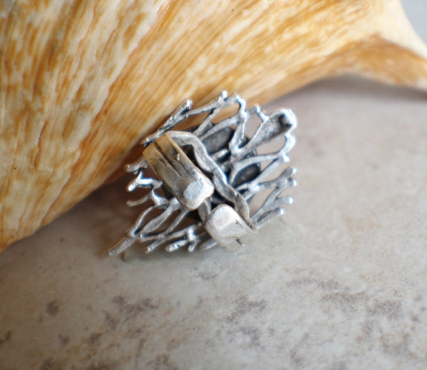 Hammered ring in antique silver plated brass with dragons breath cabochon.