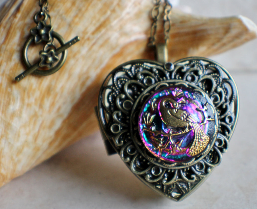 Peacock Music box locket, heart shaped with bronze accents.