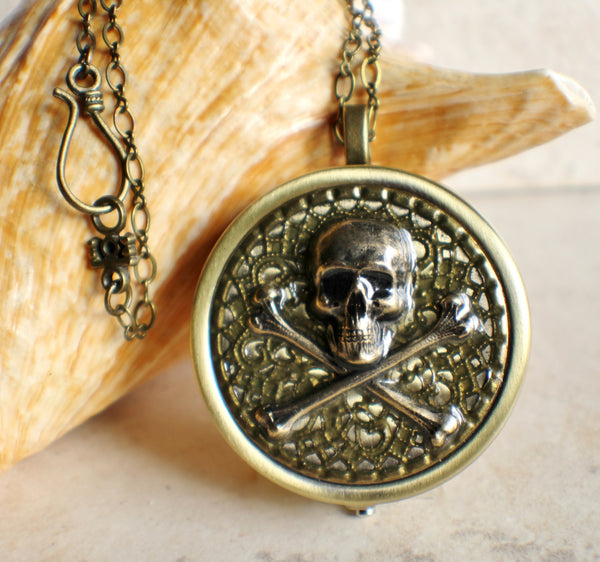 Skull and Crossbones music box locket.