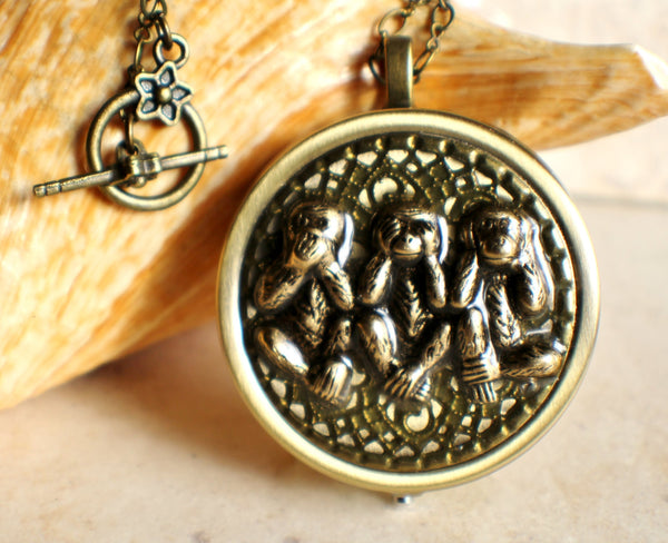 Monkey music box locket round bronze
