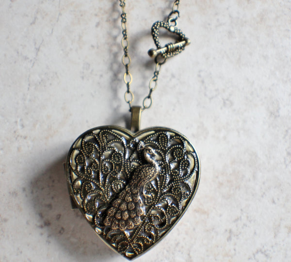 Peacock music box locket heart shaped in bronze