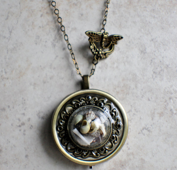 Nautical music box locket in bronze