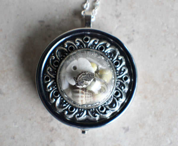 Nautical music box locket in silvertone