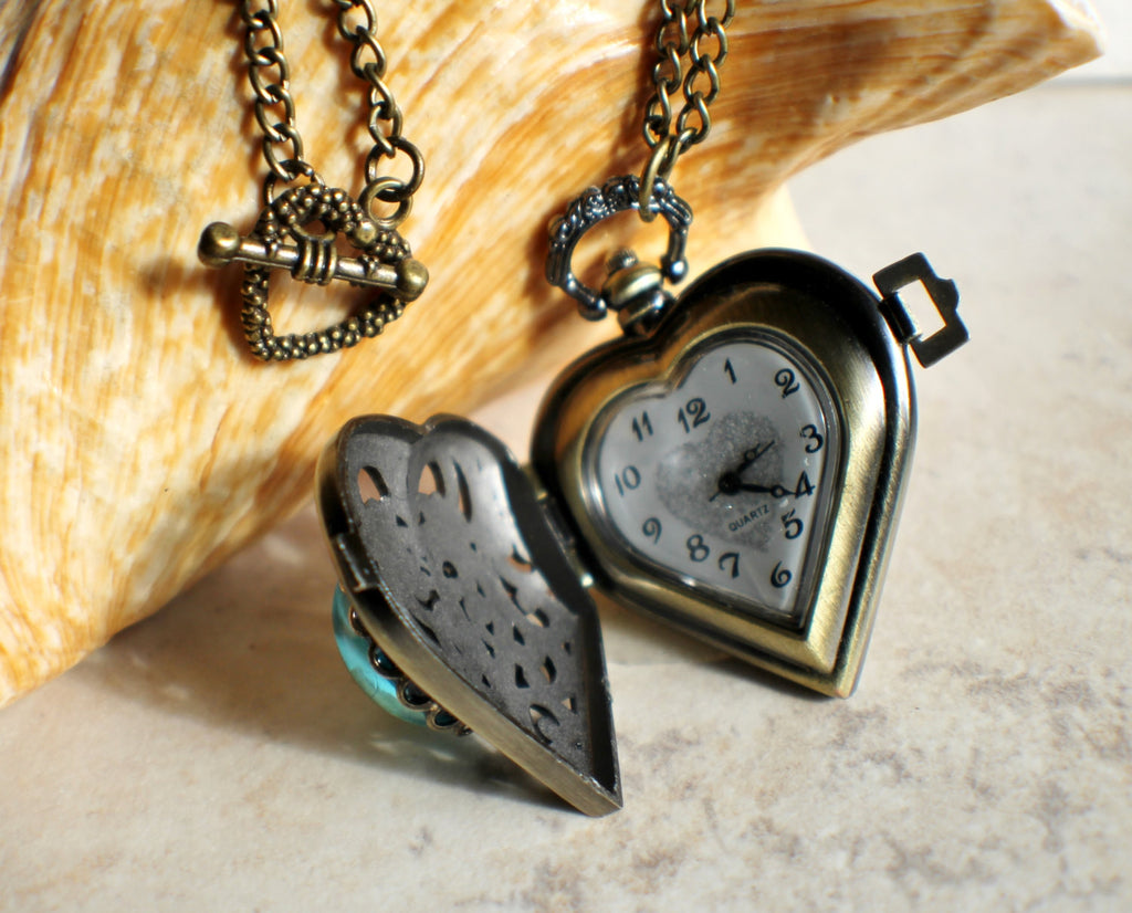 Heart watch locket with blue glass fire opal on front cover in heart watch locket with blue glass fire opal on front cover in bronze aloadofball Image collections