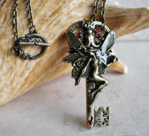 Fantasy skeleton fairy key in bronze with red crystals