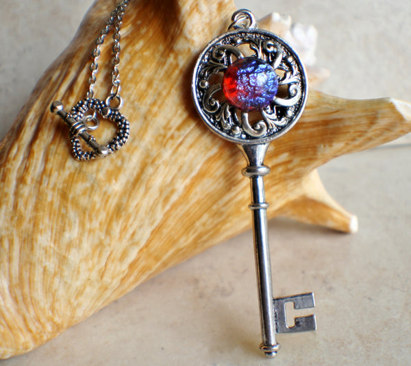 Dragons breath skeleton key necklace with silver filigree adornments.