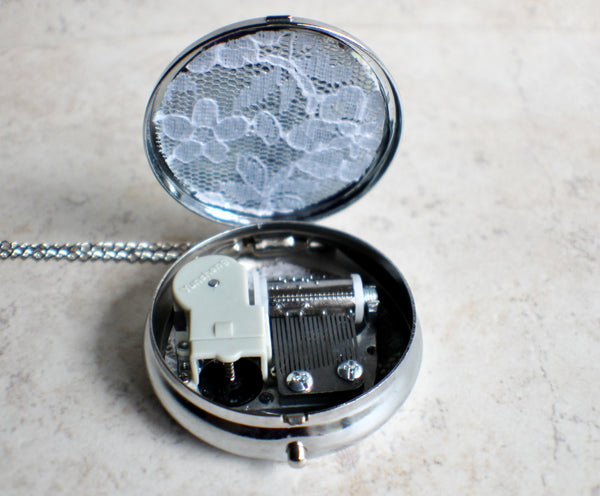 Silver Butterfly music box locket.