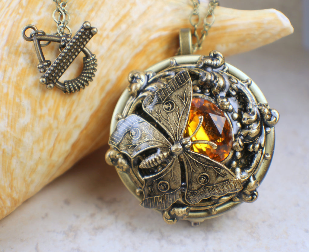 Amber crystal butterfly music box locket chars favorite things amber crystal butterfly music box locket aloadofball Image collections
