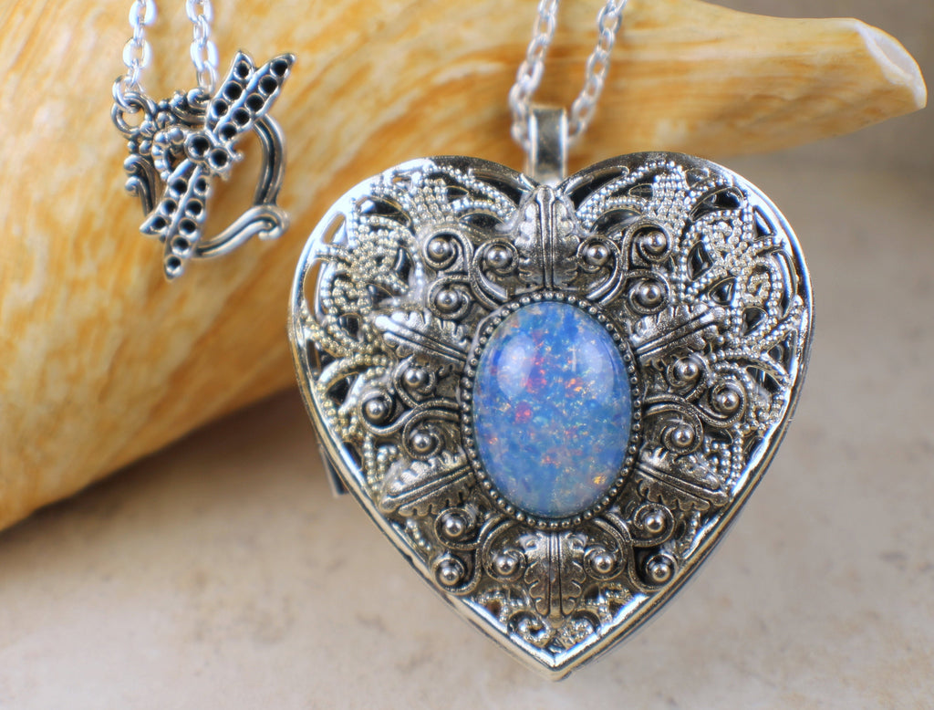 Harlequin Blue Glass Opal Music Box Locket