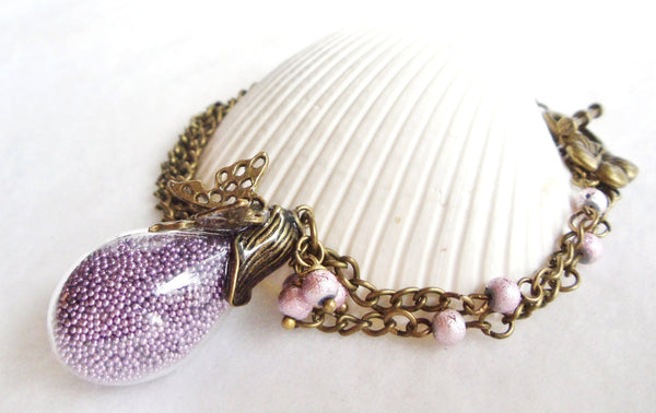 Teardrop glass orb necklace filled with delicate purple fiber beads and bronze accents - Char's Favorite Things - 1