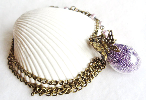 Teardrop glass orb necklace filled with delicate purple fiber beads and bronze accents - Char's Favorite Things - 3