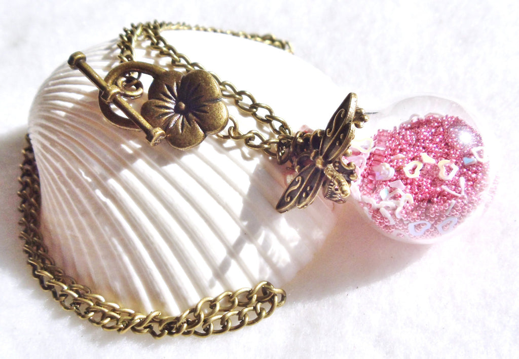 Round glass orb necklace filled with delicate pink fiber beads, hearts and bronze chain - Char's Favorite Things - 1