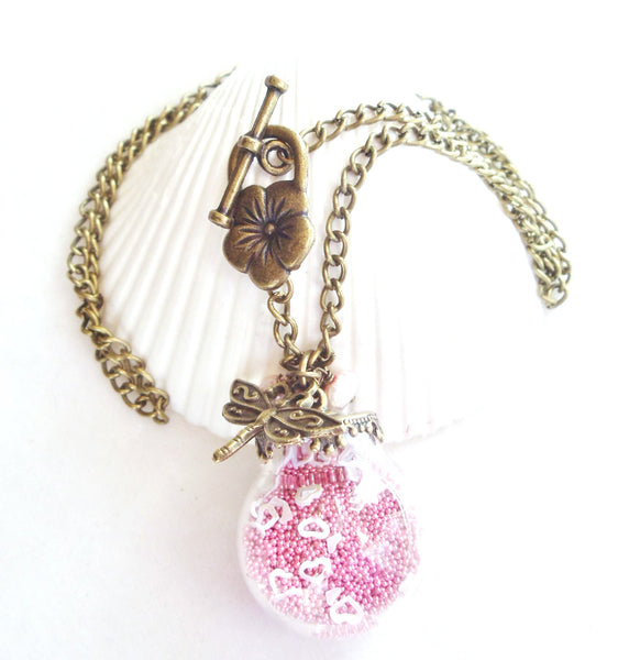 Round glass orb necklace filled with delicate pink fiber beads, hearts and bronze chain - Char's Favorite Things - 5
