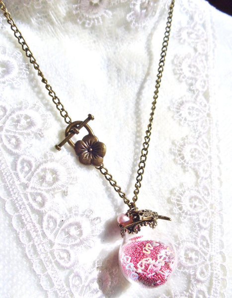 Round glass orb necklace filled with delicate pink fiber beads, hearts and bronze chain - Char's Favorite Things - 2