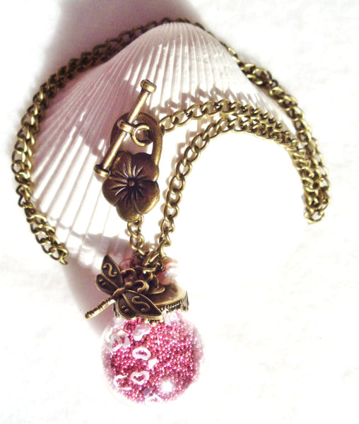 Round glass orb necklace filled with delicate pink fiber beads, hearts and bronze chain - Char's Favorite Things - 3