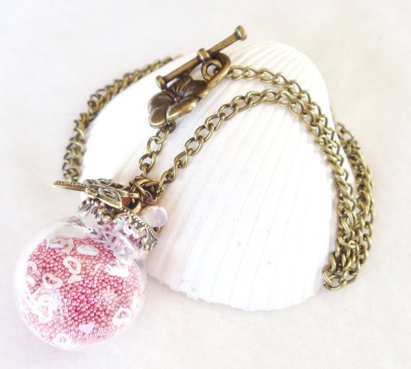Round glass orb necklace filled with delicate pink fiber beads, hearts and bronze chain - Char's Favorite Things - 4